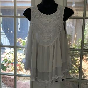 Cream colored lace tunic top